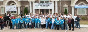 """Team """"Mansouri Family Dental Care & Associates"""" standing in front of the office on the occasion of """"Free Dental Day"""""""