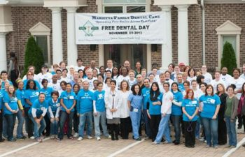 "Team ""Mansouri Family Dental Care & Associates"" standing in front of the office on the occasion of ""Free Dental Day"""