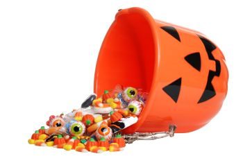 Upturned helloween bucket with spilled candies