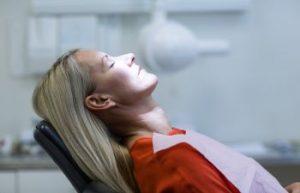 A woman in a dental chair