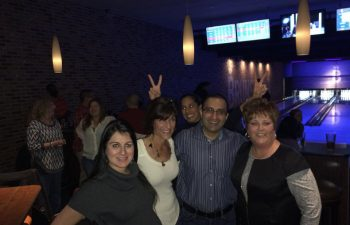 Drs. Azita and Michael Mansouri with friends at the bowling alley
