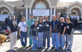"""Free Dental Day"" team in front of the clinic building"