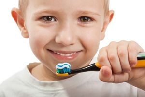 A child brushing teeth